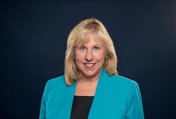 Head Nancy Hodgson wears a black blotch blazer