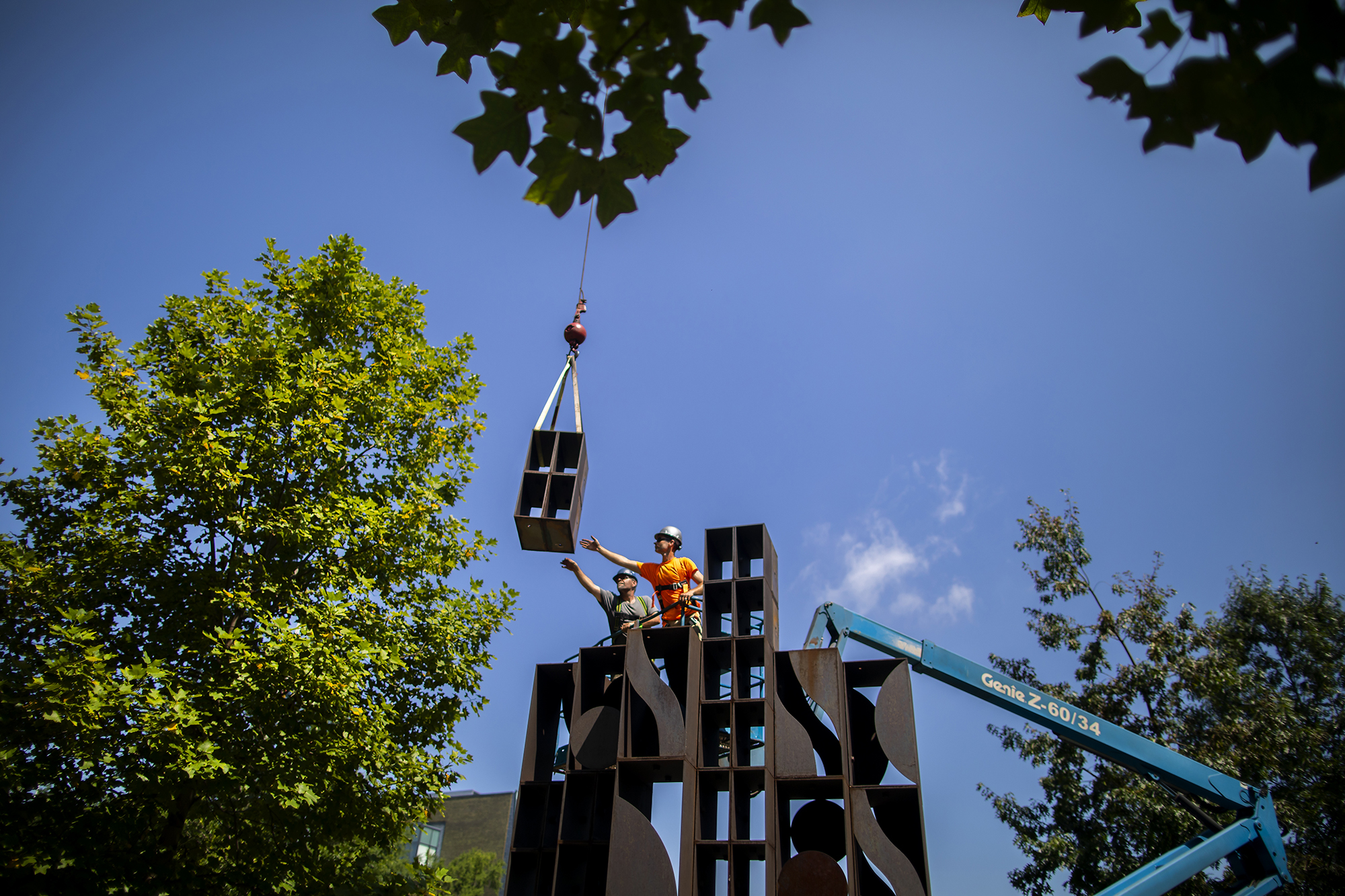 Atmosphere and Environment at Shoemaker Green hoisted by crane