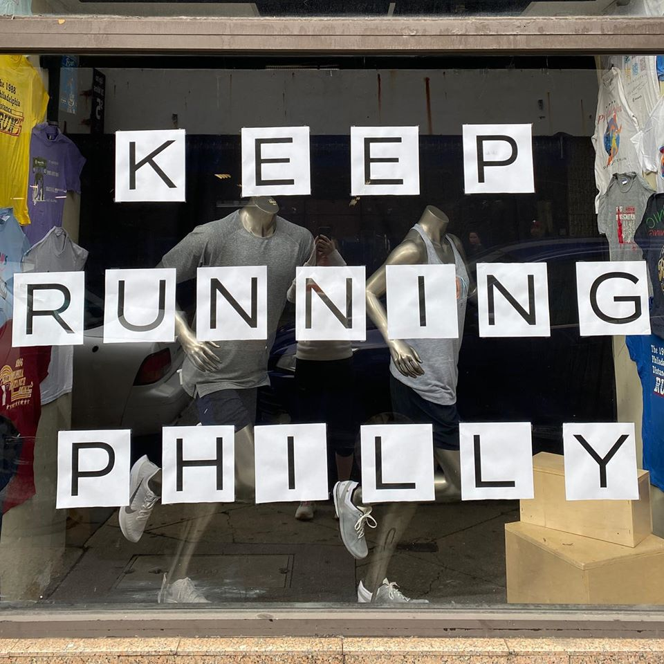"""storefront sign saying """"keep Running Philly"""""""