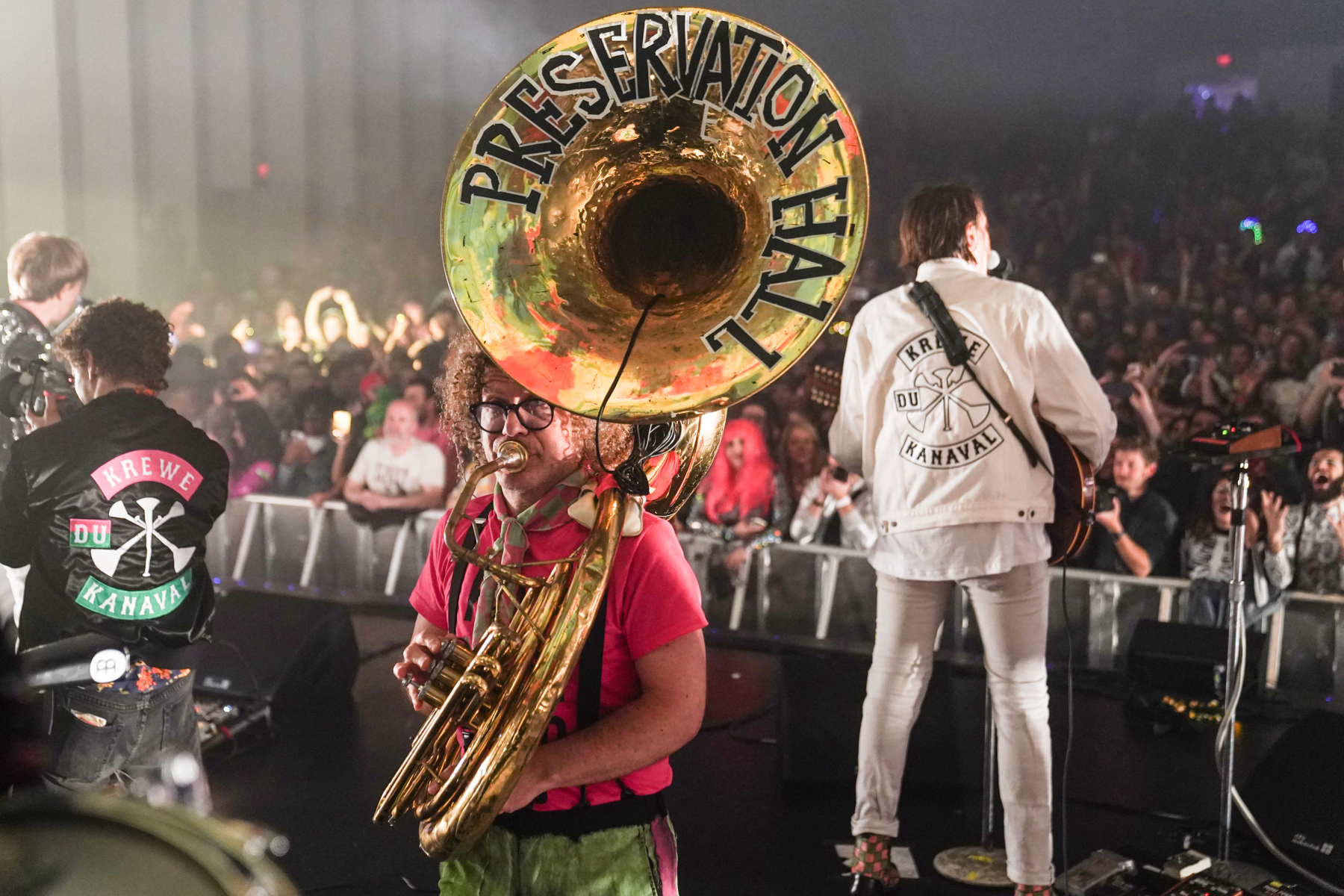 Tuba that reads 'Preservation Hall' with audience in background