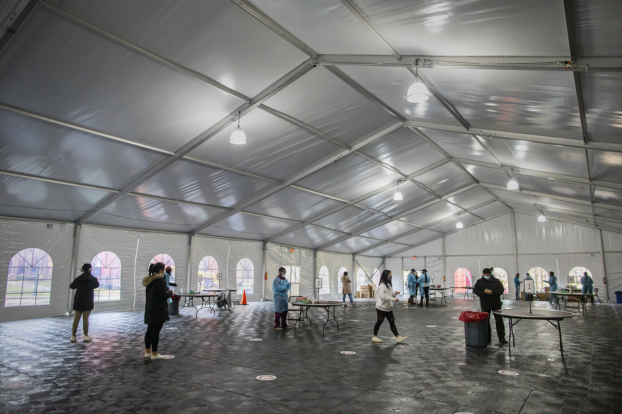 Penn students in a large outdoor tent that is a COVID-testing site.
