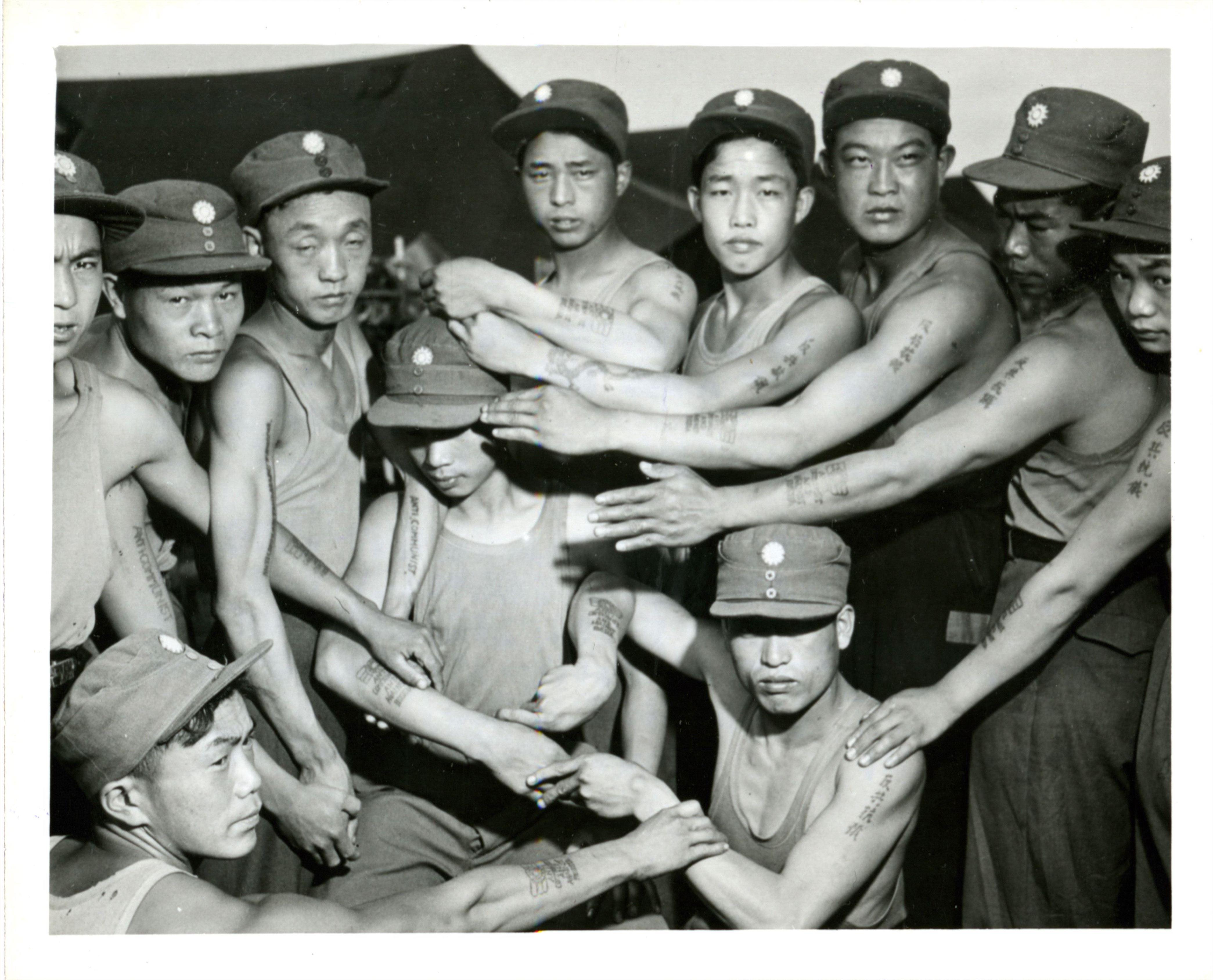 POWs show their tattoos
