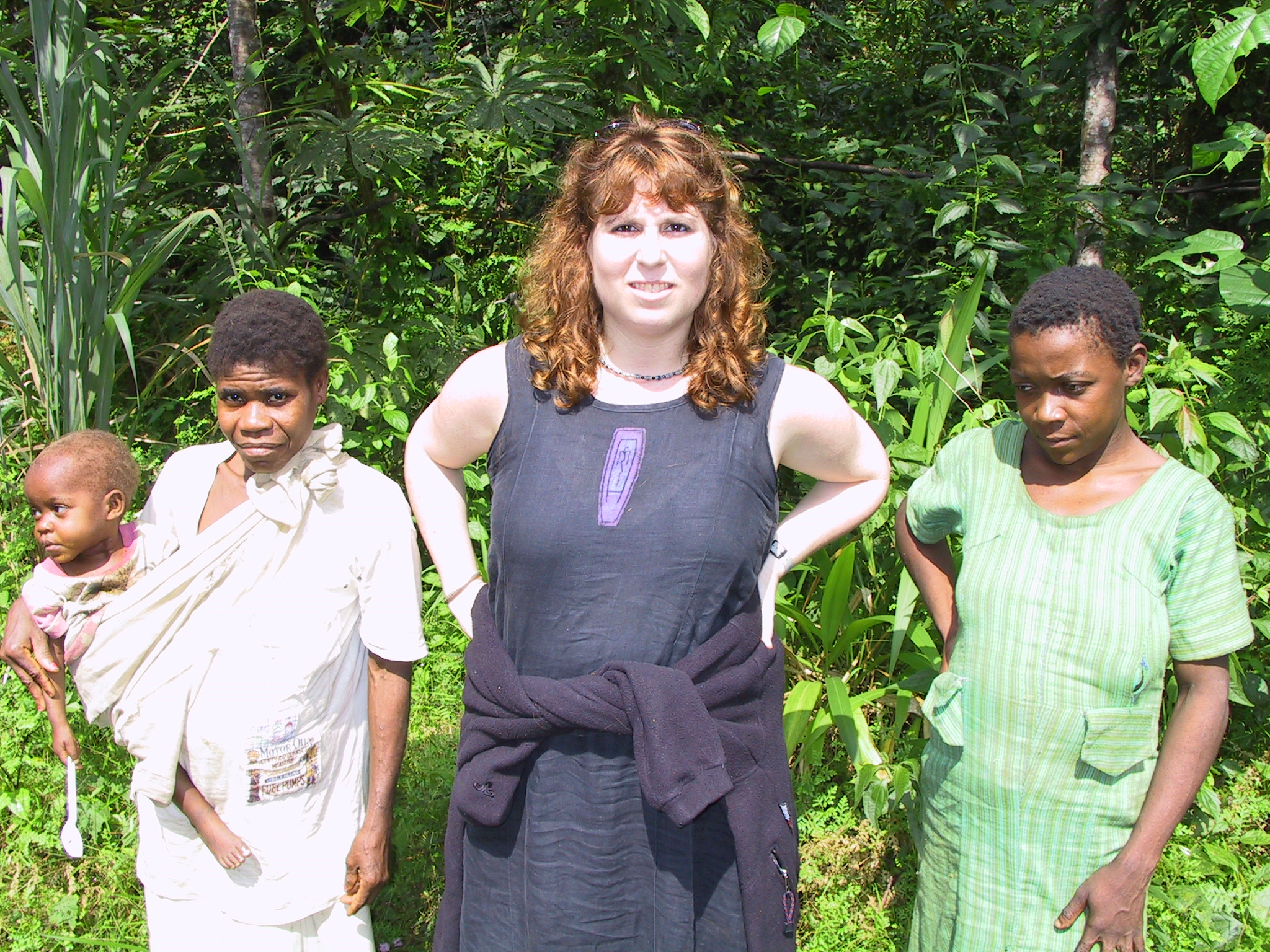 Tishkoff stands with women from the Western Pygmies of Cameroon.