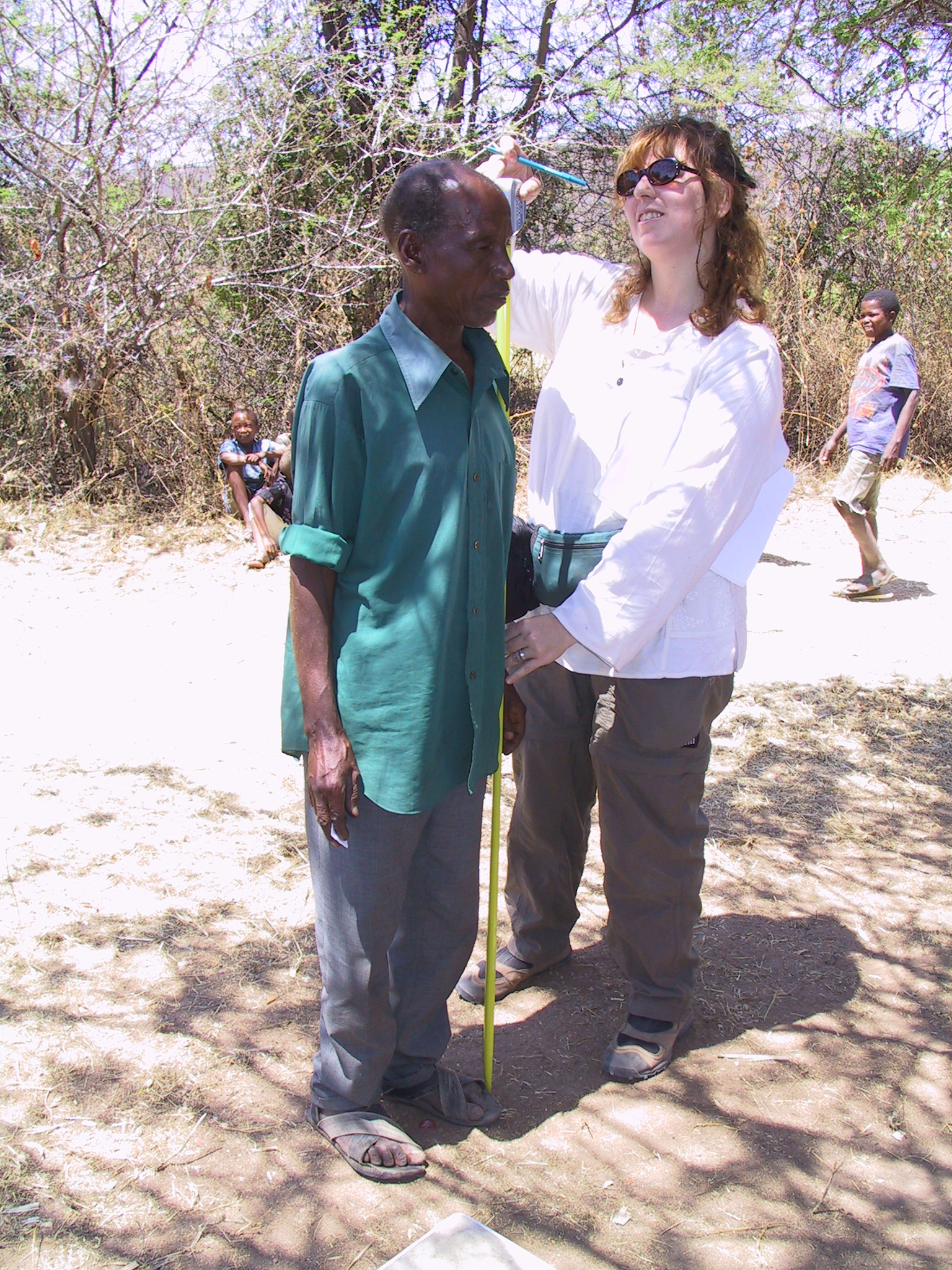 Sarah Tishkoff measures the height of a Sandawe man.