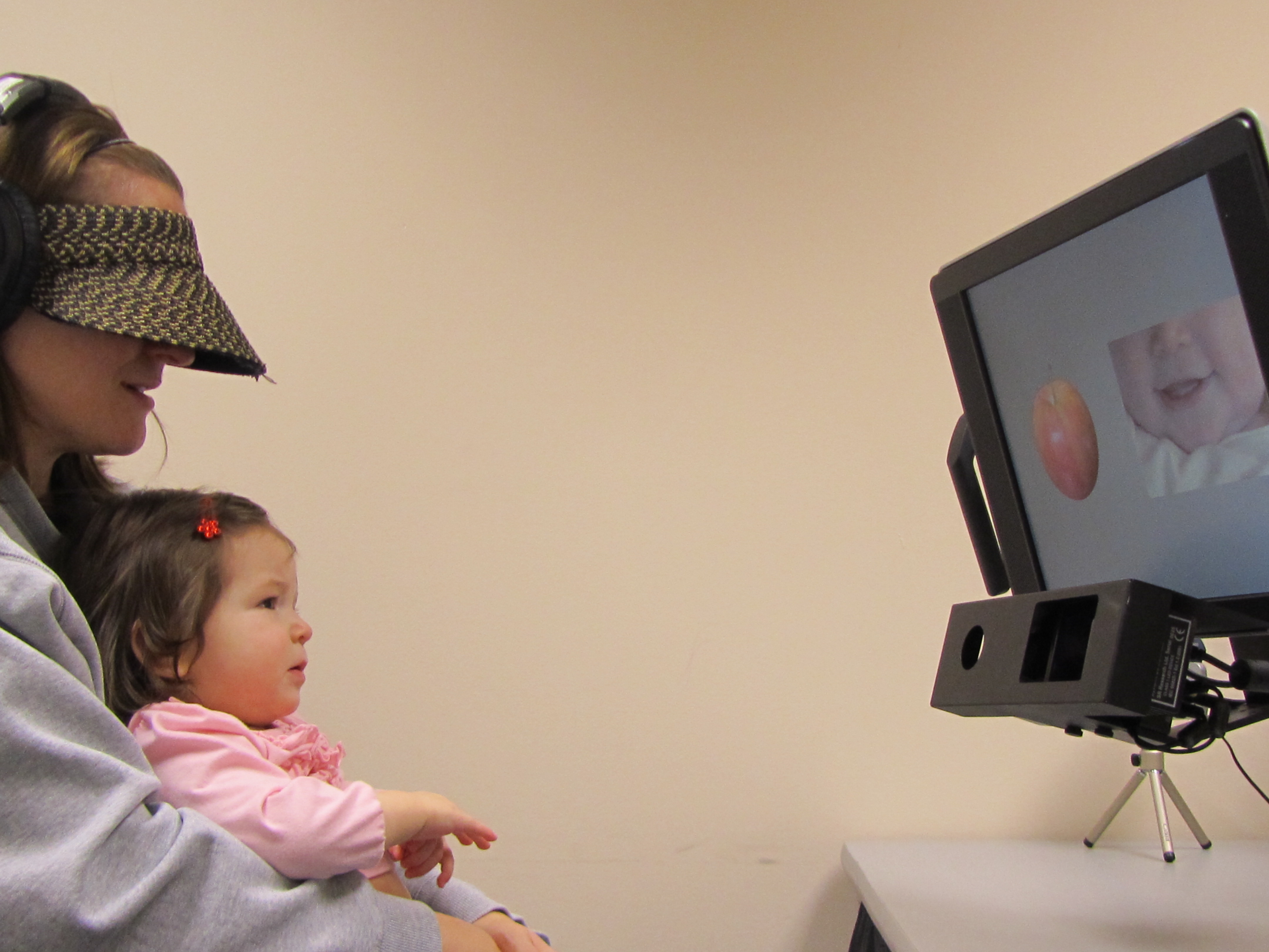 A baby participates in the study of language acquisition.
