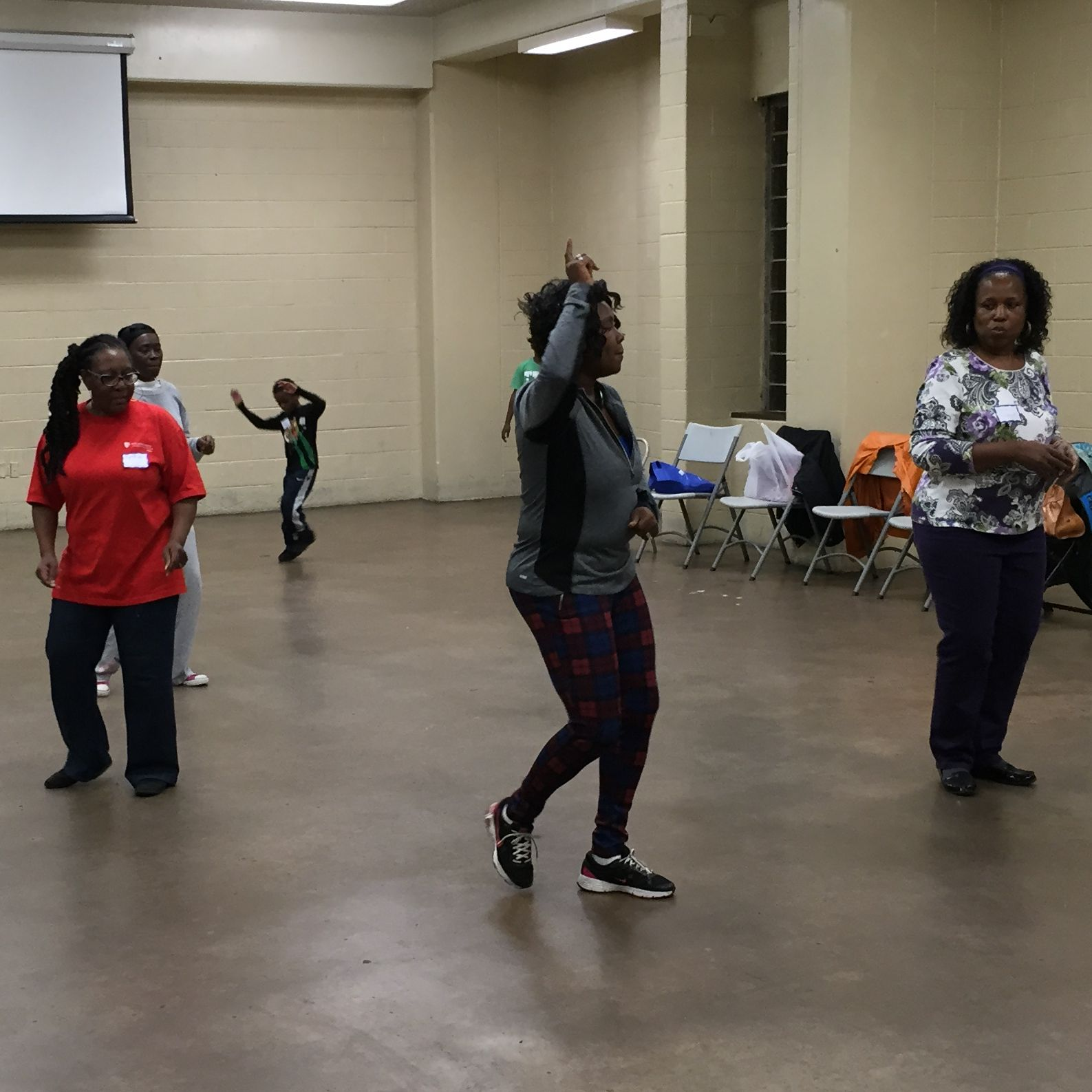 Participants of the Penn Nursing Community Champions program Dance for Health follow the lead of instructor Selena Williams.