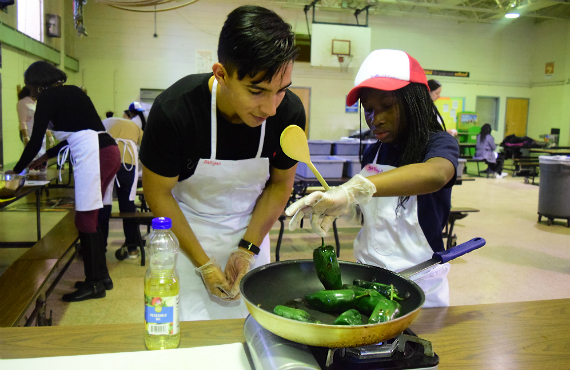 Another student in the class, Jose Maciel from Spokane, Wash. sears peppers as a part of a healthy stew. Photo: Celina Nhan