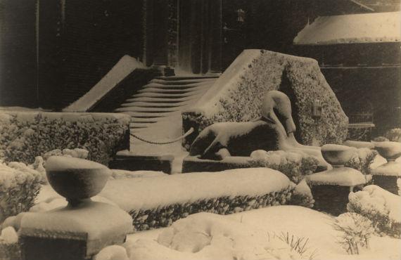 Sphinx in December 1914 snow in Penn Museum courtyard. Credit: Penn Museum