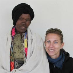 Postdoctoral Fellow Alessia Ranciaro (right) poses with an Amharic woman.