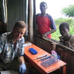 Postdoctoral researcher Simon Thompson prepares samples.