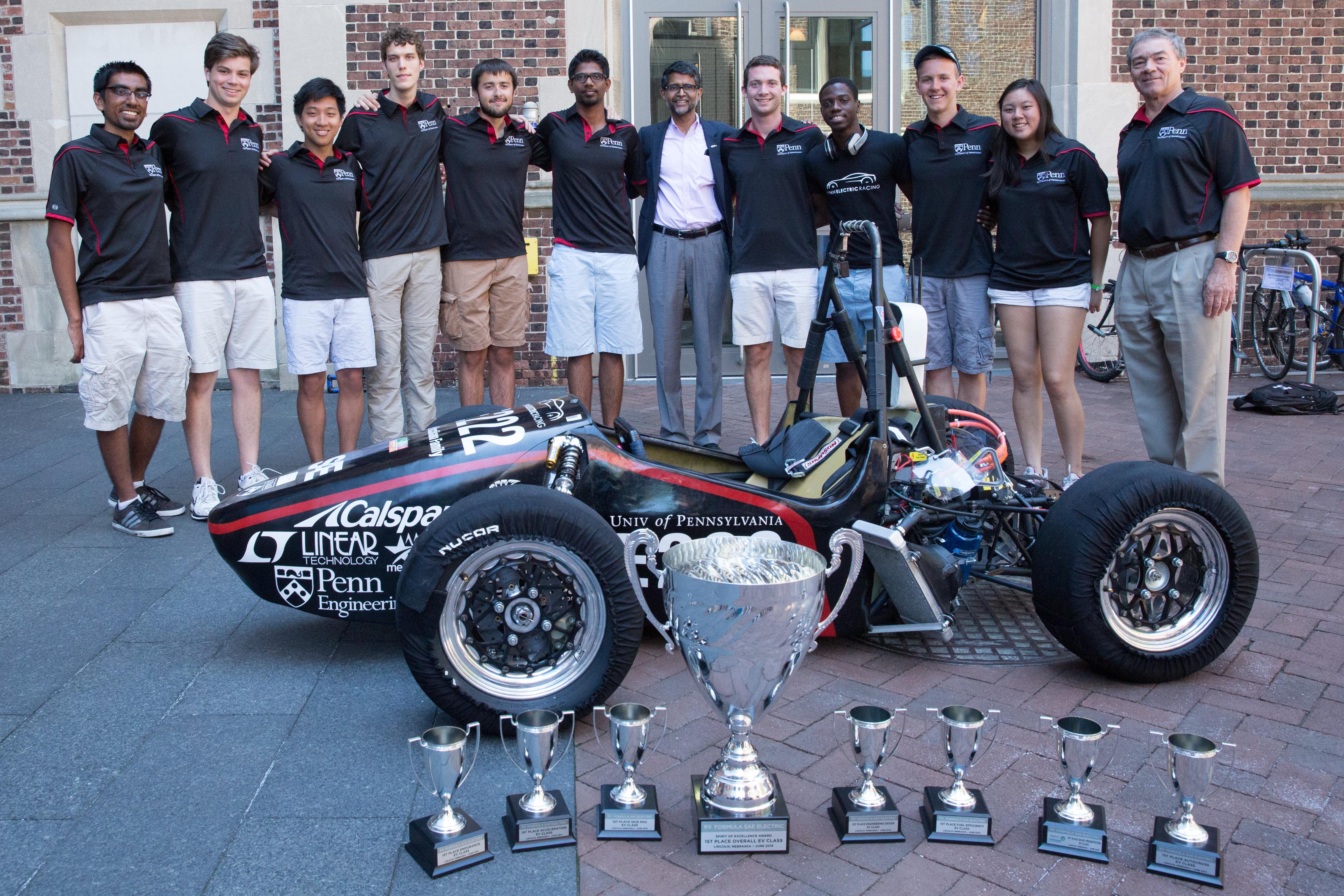 Incoming Engineering Dean Vijay Kumar poses with members of Penn Electric Racing with REV1