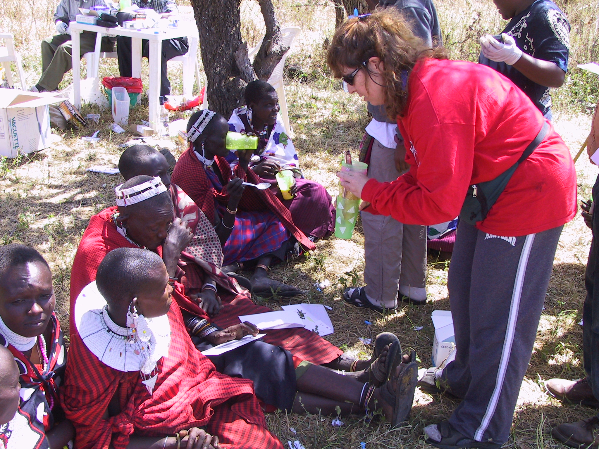 Sarah Tishkoff (at right) administers the lactose tolerance test to a group of Maasai people in Tanzania.