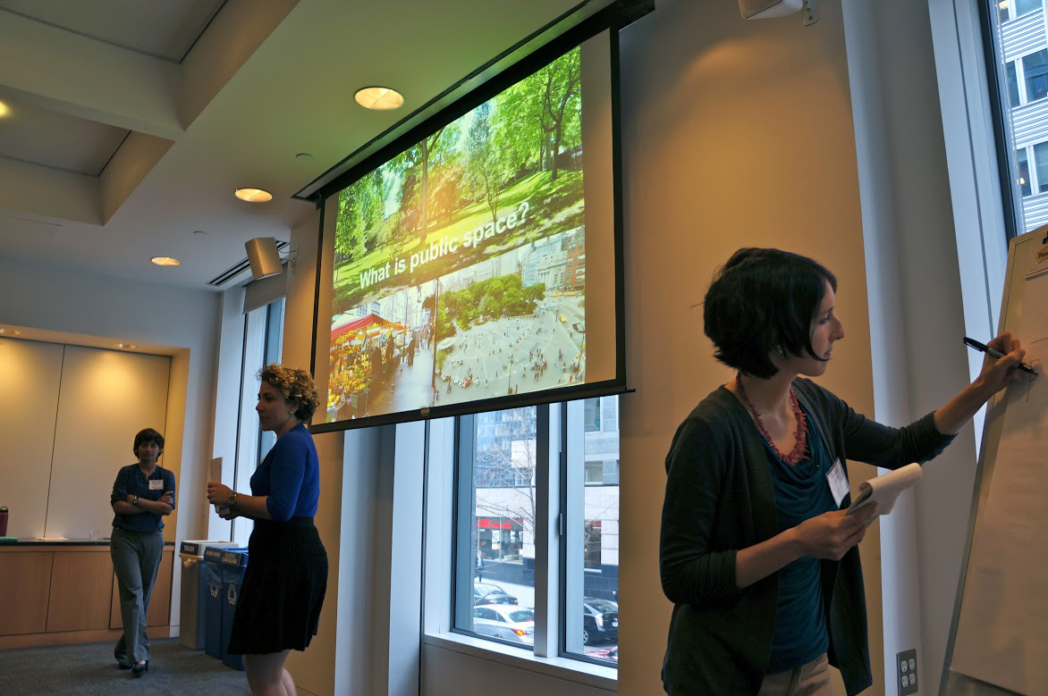 Public Spaces group presents their project at AAAS Headquarters in Washington, DC, as Madeleine Store records comments.