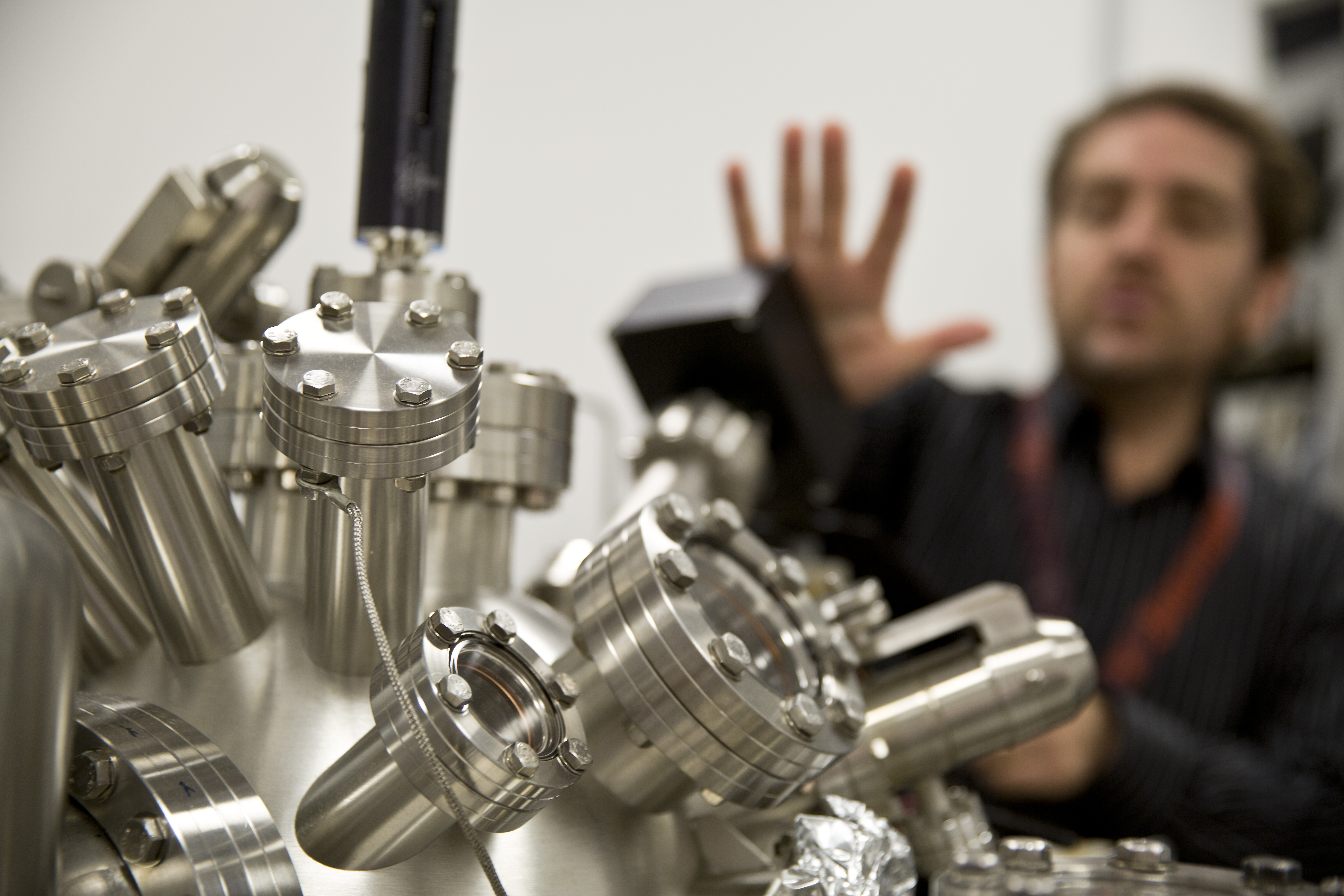 A researcher sets up one of the Singh Center's atomic force microscopes. (Photo: Steve Minicola)