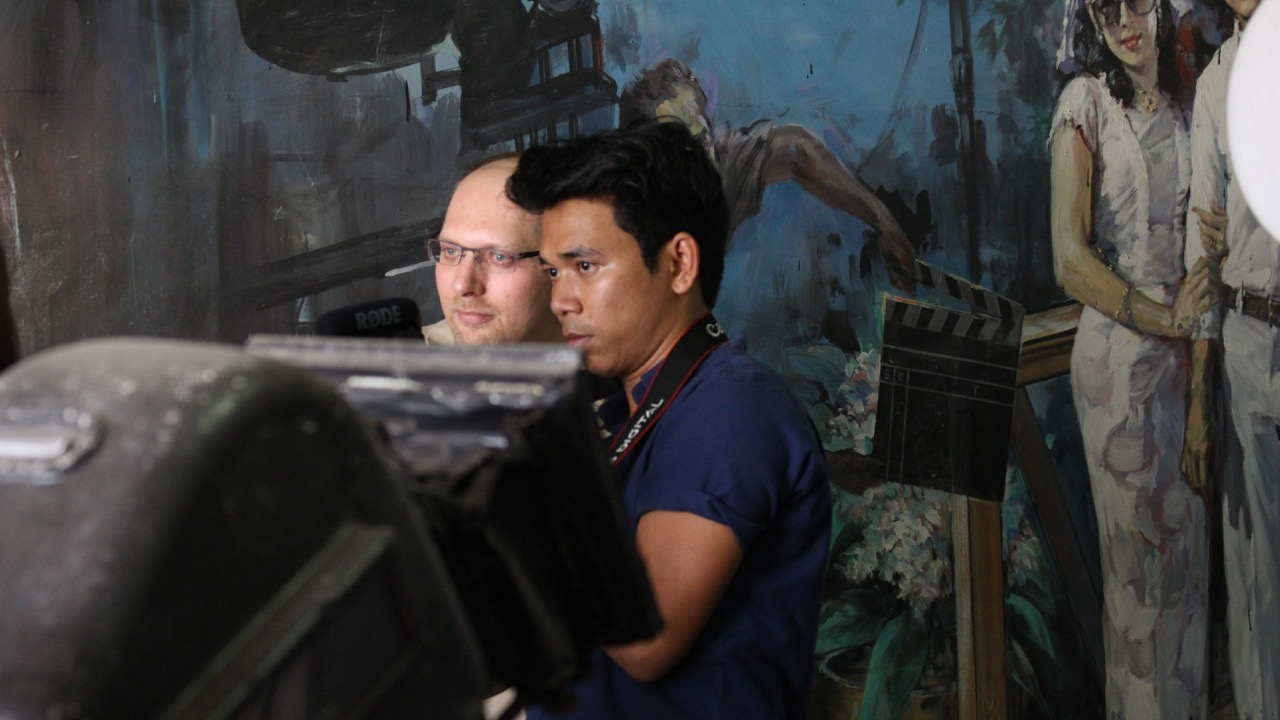 Peter Decherney confers with cinematographer Tin Win Hlaing