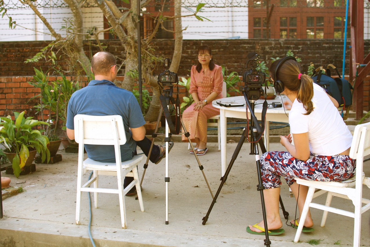 Peter Decherney interviewing Grace Swe Zin Htaik while Annenberg Ph.D. candidate Sandra Ristovska works the camera and sound