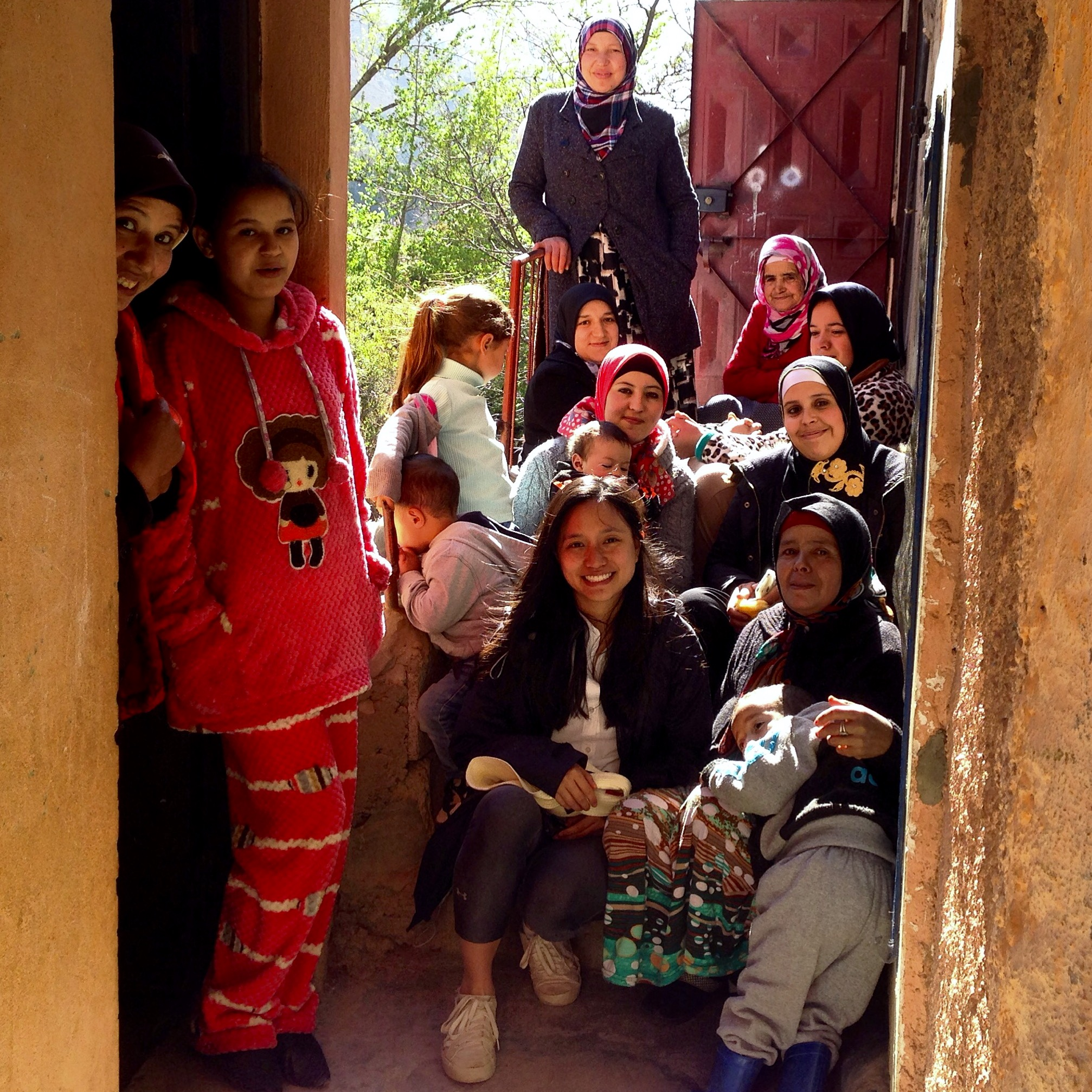 Lisa Cheung and artisans at Atlas Mountain in Morocco