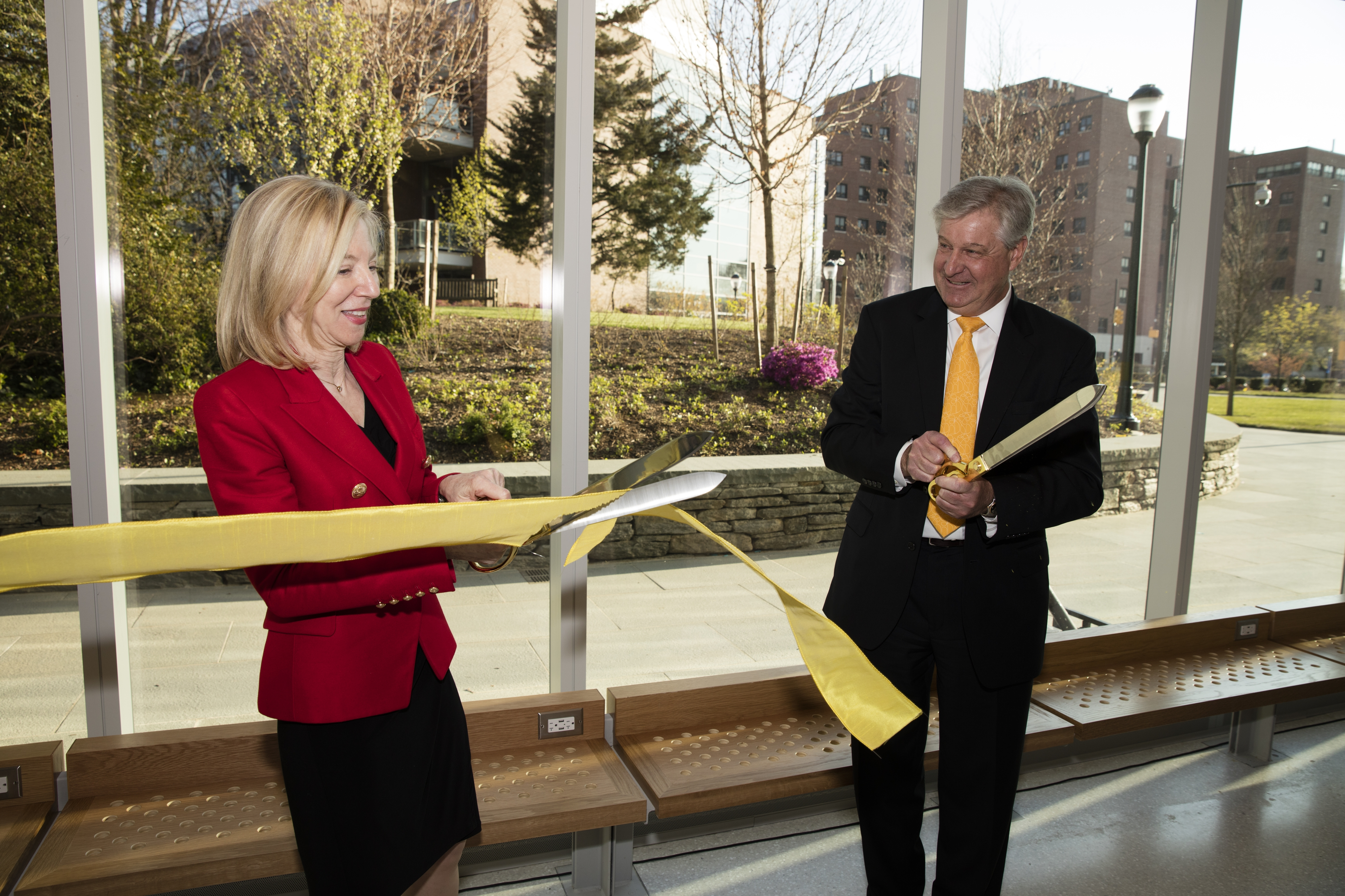 Amy Gutmann and Steven Fluharty cut the ribbon dedicating the new Stephen A. Levin Building.  Photo by Lisa J. Godfrey.