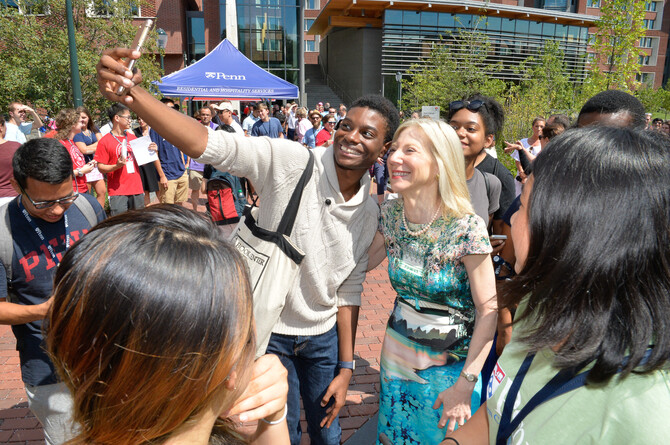 Photograph of Dr. Gutmann posing for a selfie with incoming freshman