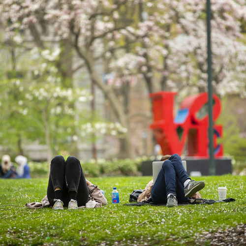Students lounging on the grass in College Green