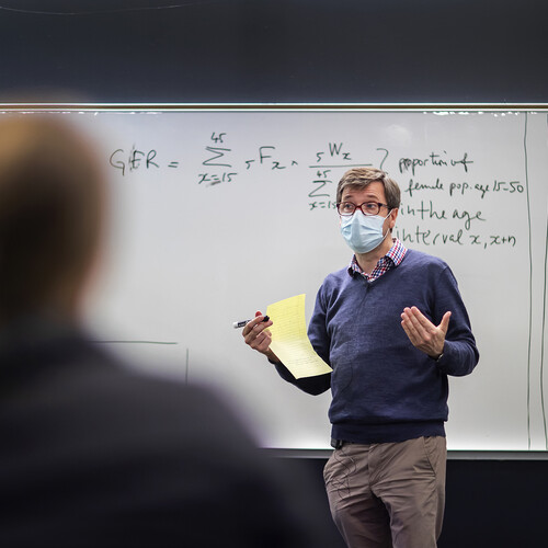in-person class with professor in mask