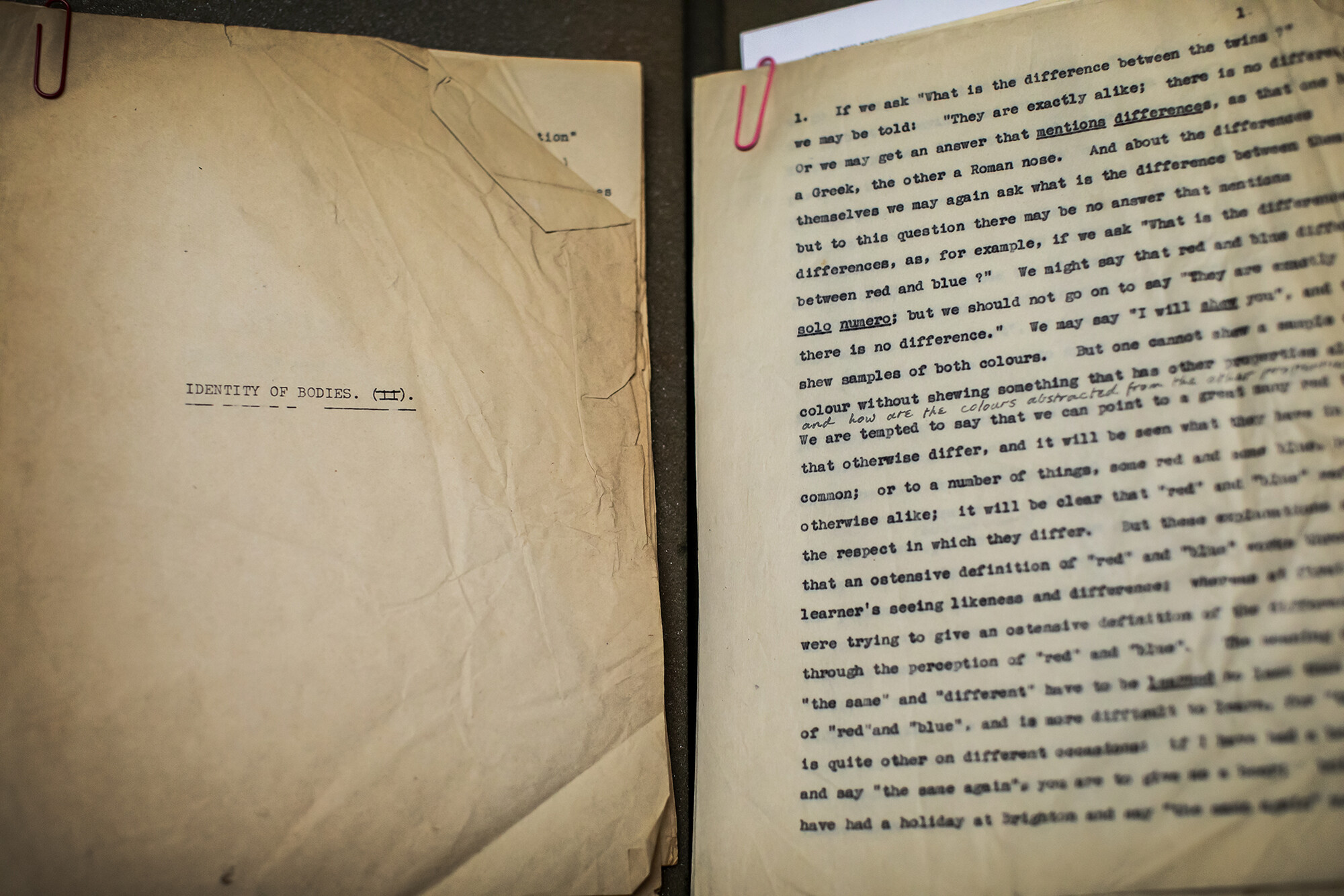 "Weathered document produced on a typewriter. The page on the left reads ""Identity of bodies."" The page on the right is a full page of text."