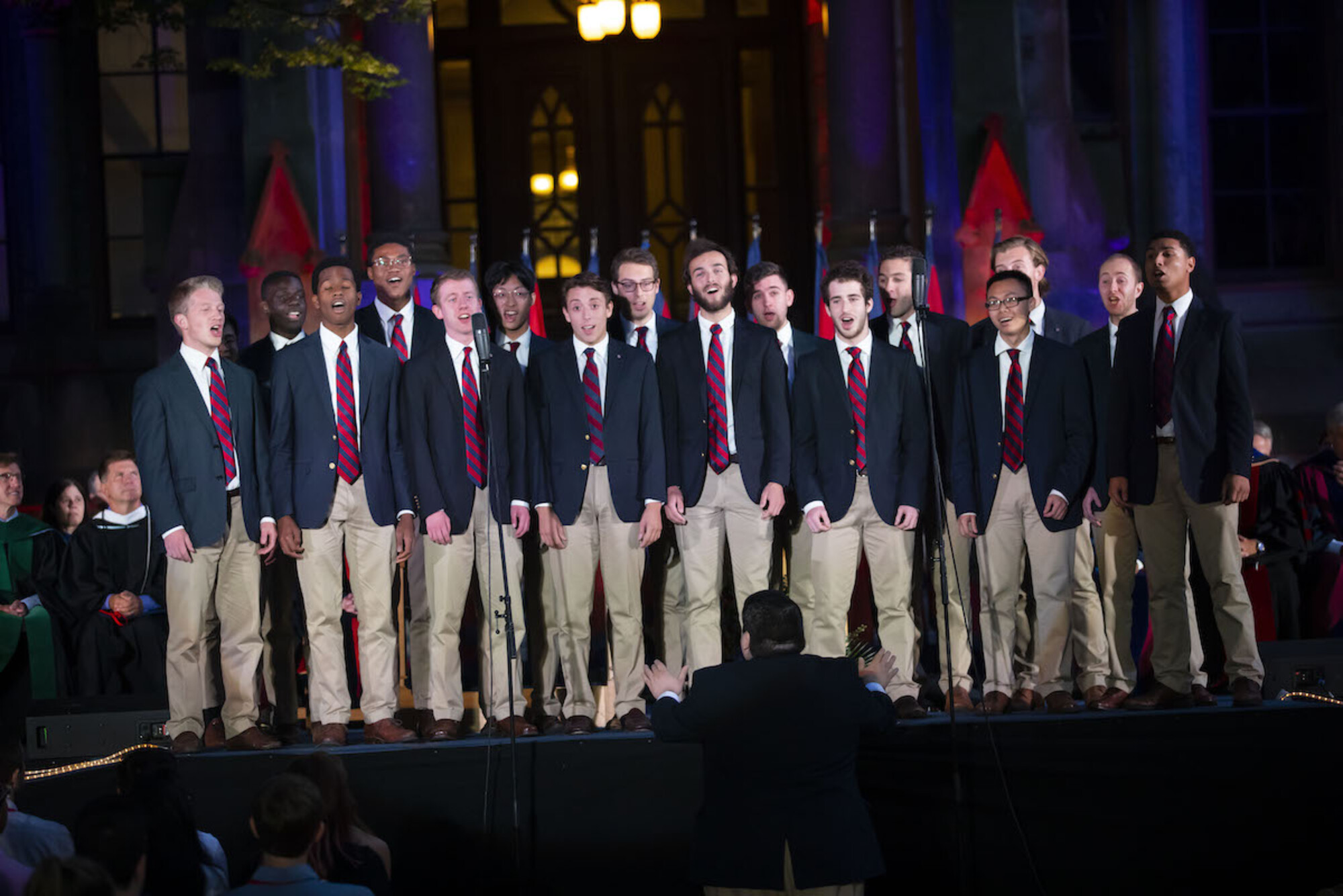 student group singing on stage in front of college hall at convocation 2019