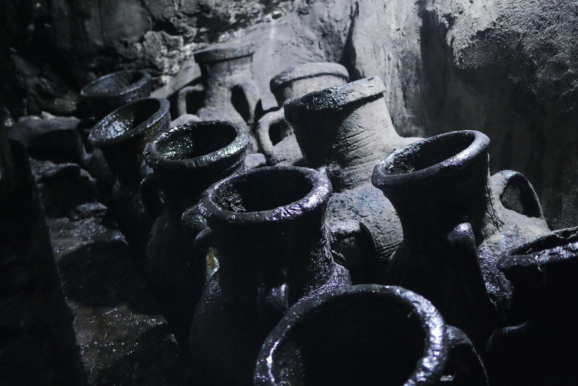 Closeup shot of 10 unearthed juglike vessels