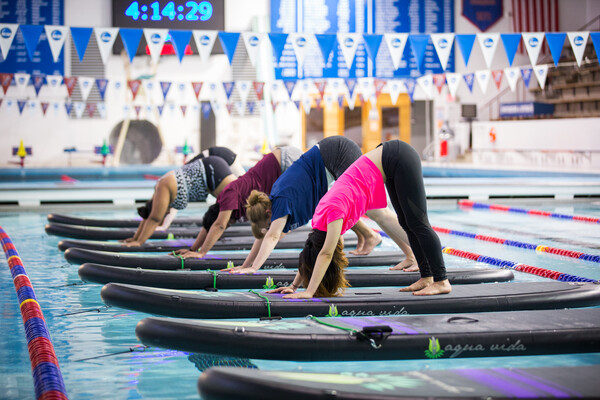 Penn Campus Recreation offered a free floating yoga class as part of its Spring into Wellness Week.