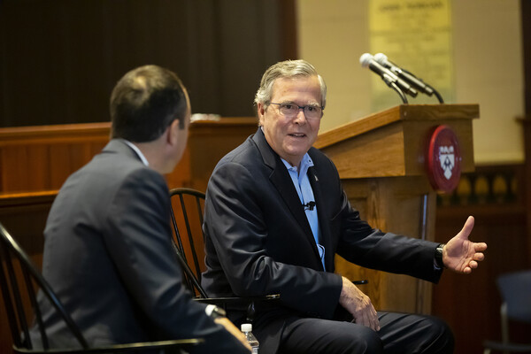 Bush-seated-in-conversation-with-Jeffrey-Green-
