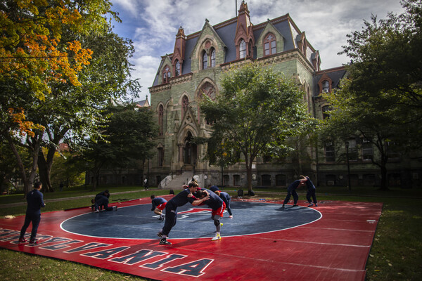 wrestling-team-practicing-outdoors-with-college-hall-in-background
