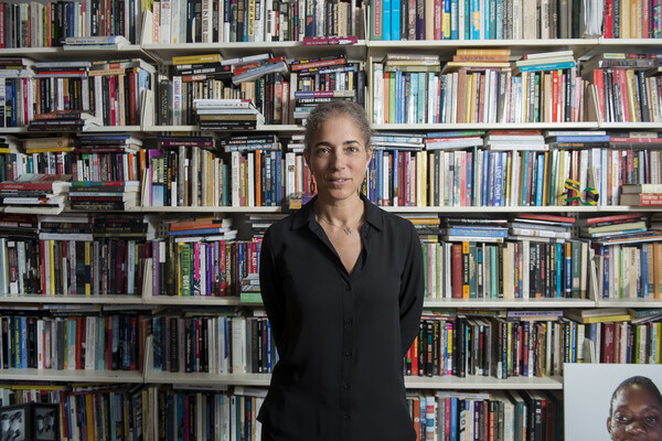 Deborah Thomas in front of bookcase