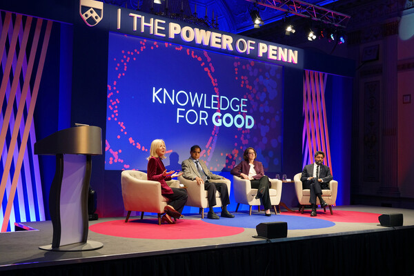 group-sitting-on-stage-power-of-penn-backdrop