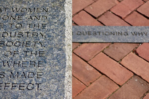 closeup of granite bench and curbing with text