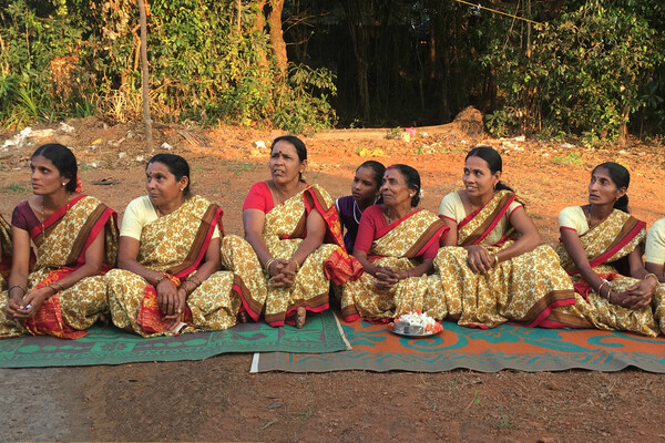 Women from a small self-help group movement in India sit at a community meeting with members of the SP2 research project.