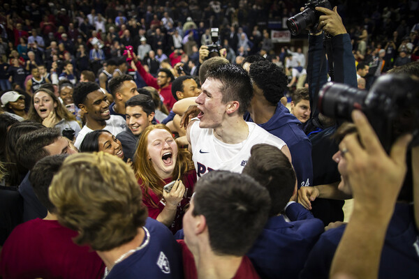 Forward A.J. Brodeur celebrates with fans on the court after beating Villanova at The Palestra