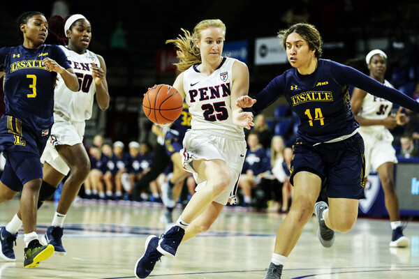Guard Ashley Russell takes the ball to the basket against La Salle at The Palestra.