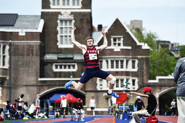 Evan Lee of the Penn track and field team performs the long jump at Franklin Field