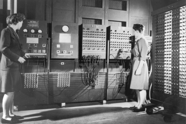 Two female programmers work on the ENIAC computer.