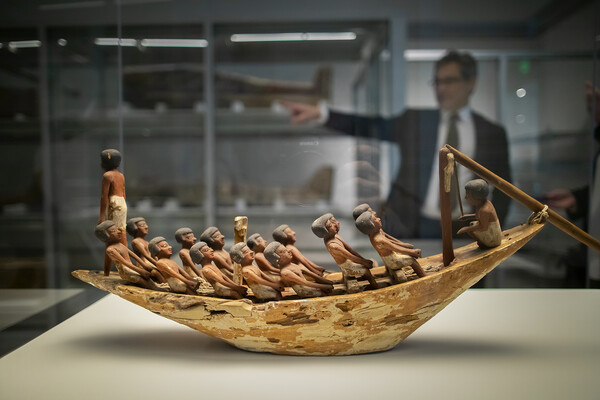 a 4,000-year-old model of a rowing boat featuring 16 figures