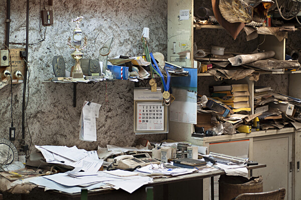 cluttered, filthy abandoned office