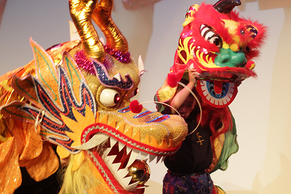 Yellow and red ornate dragon mask used in lion dance