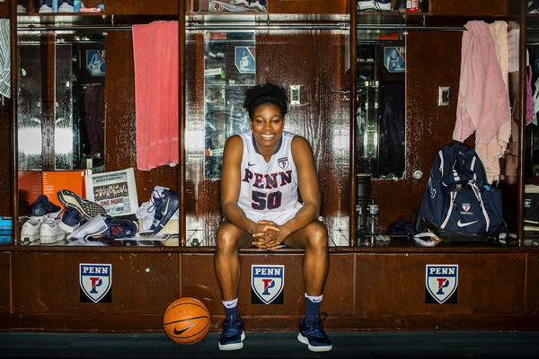 Princess Aghayere sits her her locker in the home locker room at the Palestra.