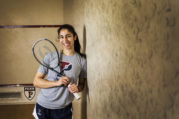 Reeham Sedky poses with her squash racket on the squash court.