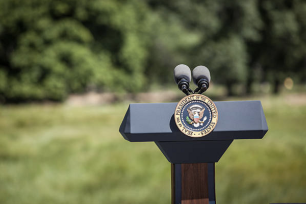 Empty podium with POTUS seal on lawn