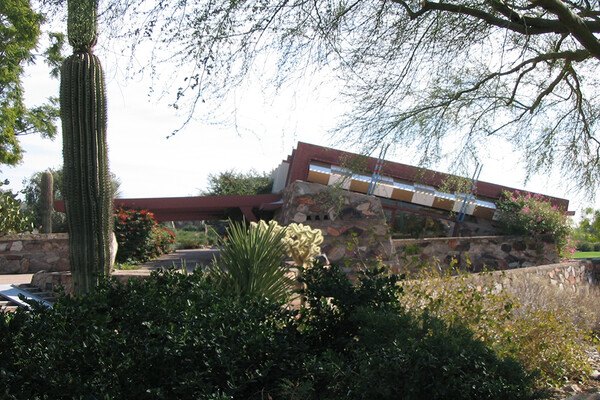 Taliesin West house exterior with cactus and trees