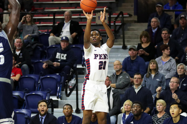 Freshman guard Bryce Washington shoots the ball against Rice at the Palestra.