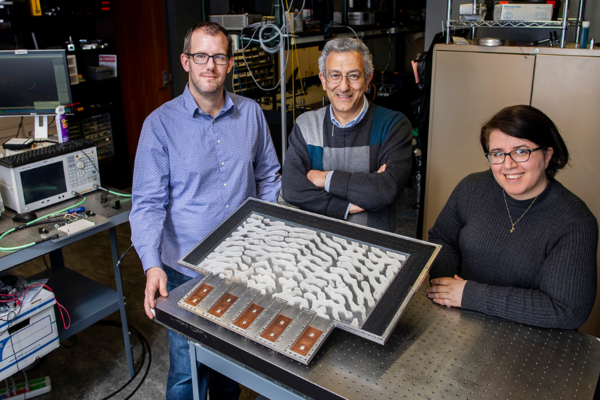 Nader Engheta, center, and two researchers who worked on the metamaterial project