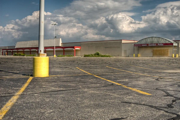 abandoned storefront and empty parking lot