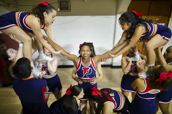 Cheerleaders prepare to lift up Maya Moore during a Penn basketball game.